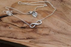 Royal Infinity Sideways necklace Sliver tone Chain by tranquilityy, $8.00