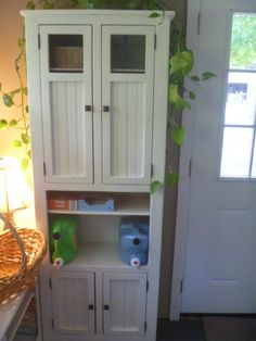 Cottage style linen cabinet, bead board, wire door, jelly cabinet, bathroom cabint, beach, rustic, laundry room