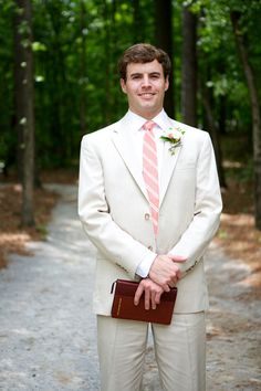 cream groom look with pink and white striped tie http://www.weddingchicks.com/2014/02/27/sophisticated-stable-wedding/