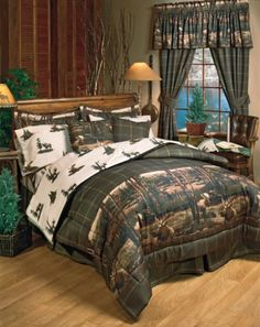 The Moose Mountain Bedding by Blue Ridge Trading is perfect for those who like the peaceful feel of nature with a realistic moose scene in a background of pine trees and mountains. This rustic cabin bedding starts with a comforter on a deep green and tan checkered plaid print background with a life-like, realistic moose scene at the foot with a pine tree and mountain background.