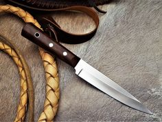 "The Wolhuter Game ranger knife, by South African knife maker Louis Naude knives. It is a legendary knife with a story. You can read the story written by the famous game ranger in his ""Memories of a game-ranger"" by Harry Wolhuter. The knife on the picture has a Iron Wood handle. It is available from Louis Naude knives (LEO Knives).  Louis Naude knives ships worldwide."