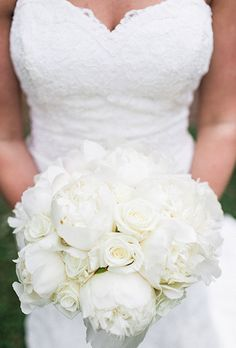 Brides.com: All-White Wedding Bouquets. An all-white bouquet made of peonies and roses created by North Carolina-based florist Amy Lynne Originals. Photography by Sara Logan Photography