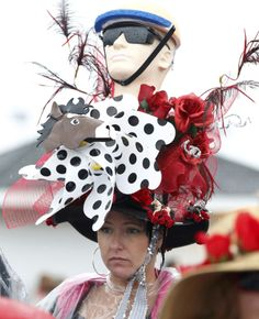 MATT SULLIVAN / REUTERS A spectator has her elaborate hat getting wet in the rain as she awaits the running of the 139th Kentucky Derby horse race at Churchill Downs in Louisville, Kentucky May 4, 2013.