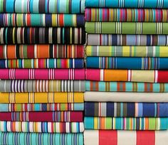 Revamp your old deck or director's chair with beautiful, bright, multi striped deck chair fabric.   deckchairstripes.com
