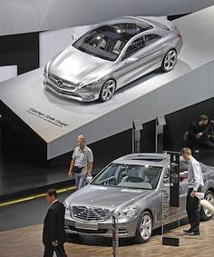 BEAUTY ON WHEELS: Partial view of the Mercedes stand with a concept car, top, and a Class S model, bottom, on the eve of the opening of the Paris Auto Show. (AP)