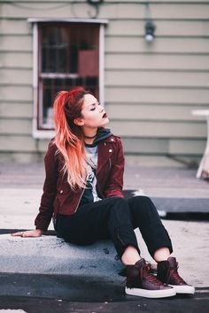 Le Happy wearing Obey burgundy jacket and Buscemi sneakers