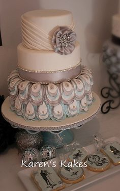 Gorgeously designed wedding cake in shades of white, blue and grey with unique detail...love this! Created by Karen Hedge, owner of Karen's Kakes, McEwen, Tennessee....