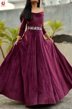 Look absolutely stunning in this beautiful wine velvet off shoulder padded gown from Colorauction. The gown has beautiful handwork Embroidery on the waist line exuding class & elegance. This gown will fetch you compliments from everyone around for yo Indian Wedding Gowns, Pakistani Wedding Outfits, Indian Gowns Dresses, Indian Fashion Dresses, Pakistani Dresses Casual, Indian Long Dress, Dress Indian Style, Prom Dresses, Velvet Dress Designs
