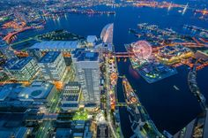"""This is a view from Minato Mirai 21 in Yokohama. Taken during the blue hour, using a tripod and through a window. I was able to avoid most of the window reflection using my jacket, some of them still remain in the picture :(  <a href=""""http://www.flickr.com/photos/worldtowalk/8732002221/in/set-72157636393942015/lightbox/""""> To see my set of Japan, click here. </a>"""