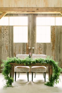 sweetheart table with fern garland   Mustard Seed Photography