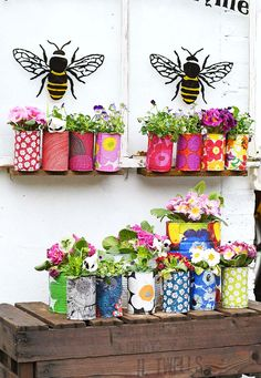 Create a riot of pattern and colour in your garden with some DIY Marimekko decorative tin can planters. This is a cheap and easy upcycle using paper napkin decoupage. Marimekko, Painted Tin Cans, Paint Cans, Tin Can Flowers, Flower Boxes, Diy Planters, Planter Ideas, Paint Can Planters, Recycled Planters