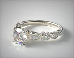 14K White Gold Ribbons and Bows Engagement Ring | The curving designs and charming feminine feel of the ribbons, bows and flowers on this unique engagement ring are sure to create the perfect package for the diamond and gemstone of your choice. | Ring Style: 17551W14 on JamesAllen.com. Click to view this ring in 360° HD.