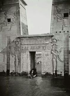 Entering on boat into the Temple of Isis, Philae, Egypt, photographer unknown. It was flooded because of the creation of the Aswan Low Dam (built in until relocation in Ancient Egyptian Art, Ancient Ruins, Ancient Artifacts, Ancient History, Egyptian Temple, Mayan Ruins, Ancient Greek, Art History, Old Egypt