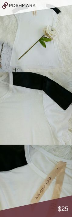 """💞SALE💞 Bailey 44 White T w Black Leather Sleeves Fantastic Bailey 44 White T with Black Faux Leather Sleeves 26"""" from the top of the shoulder to the bottom 17"""" from armpit to armpit 96% Rayon 4% Spandex Bailey 44 Tops Tees - Short Sleeve"""