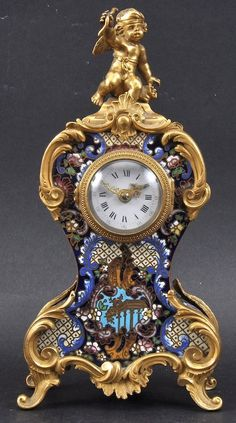A 19TH CENTURY FRENCH ORMOLU AND CHAMPLEVE ENAMEL MANTL : Lot 1354