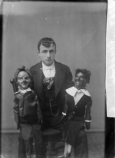 Ventriloquist and his dolls, c. 1885.