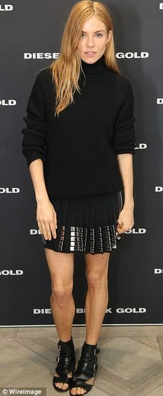 Back in black: Sienna Miller, 32, couldn't rock the turtle neck but the shoes and skirt are banging