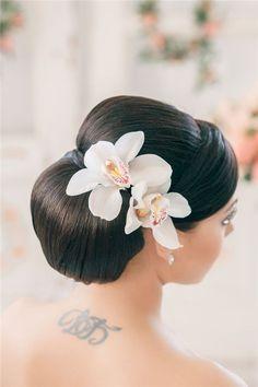 simple wedding updo with flowers / http://www.deerpearlflowers.com/25-romantic-long-wedding-hairstyles-using-flowers/