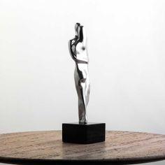 Escultura Envolvimento Alumínio  | iBacana