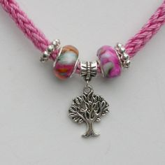 This #necklace combines European #Beads and soft pink #yarn with a Silver Tree of Life Pendant, by SusanEknits.etsy.com , $20.00
