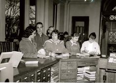 An old photo of library patrons using the Greenville Public Library in Greenville, Ohio, in the 1970s. This photo is taken at the reference desk, which was the circulation desk at the time.