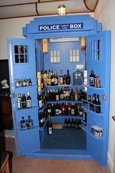 "Tardis drinks cabinet, by ? - someone known as ""whovian da milkman"" -  (possibly). Nice build whoever did it.  Sadly, only seems bigger on the inside when you've imbibed too much of the contents. Does, however, work effectively as a time machine - go in for a drink or two, and emerge several days later!"