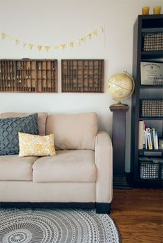 Light gray walls with accents of yellow.     tags: yellow, gray, brown, black, interior, vintage modern