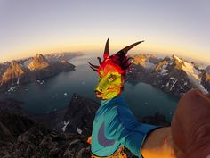 Nat Geo Explorer of the year!     Libecki, wearing a dragon mask, is seen on the summit of Greenland's 4,610-foot Ataatap Tower (Daddy's Tower) after making the first ascent—on sight, free solo—in three hours.