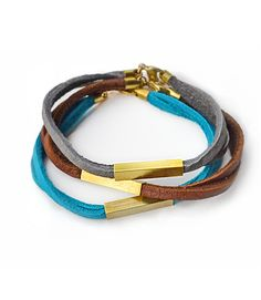 central point bracelet  Turquoise, chestnut, or grey leather sets off a squared brass tube. Very   simple, very soft, wear 'em like your favorite jeans.