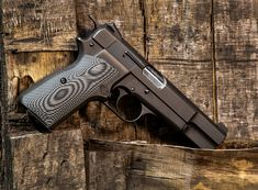 Our Hi-Power grips are some of the most comfortable out there. They are slimmer than the factory grips that come with your Hi-Power. Also available in a palm swell version as seen here. Weapons Guns, Guns And Ammo, Custom 1911 Grips, Pistols, Swords, Firearms, Hand Guns, Palm, Board