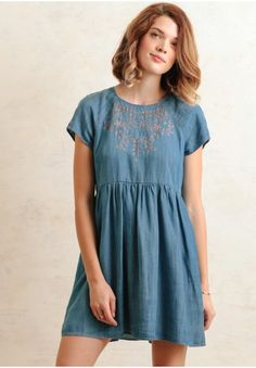 A look for a picnic in the park, this blue chambray dress is designed with medium blue wash and brown embroidery and eyelet accents at the front.