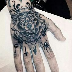 Wolf Tattoo Design on Hand - Tattoo Shortlist Wolf Tattoos, Knuckle Tattoos, Animal Tattoos, Finger Tattoos, Black Tattoos, Body Art Tattoos, Tattoo Drawings, Sleeve Tattoos, Arabic Tattoos