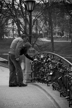 Lock bridge in Riga, Latvia...newlywed couples walk to the bridge after their ceremony and put an engraved lock w/their initials on the bridge then throw the key into the river below. so romantic