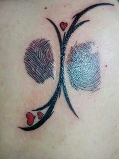 Tattoo with fingerprints from my mother and father.  Made by Tattoo Zalm.