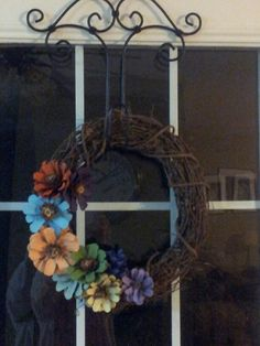 Grapevine wreath with painted pinecone flowers