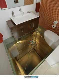 Glass-floor-toilet/bathroom/powder room in a penthouse apartment in Guadalajara, Mexico. Built over an unfinished elevator shaft that goes down 15 stories. Reinforced glass, of course. Luxury Penthouse, Glass Floor, Bathroom Toilets, Glass Bathroom, Funny Bathroom, Washroom, Bathroom Art, Bathroom Vanities, Bathroom Cabinets