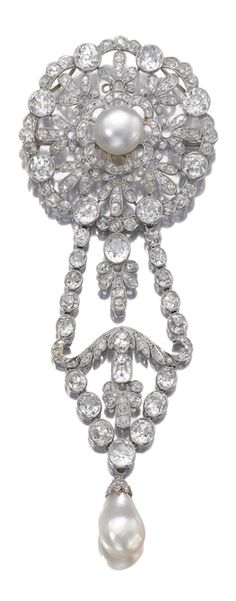 NATURAL PEARL AND DIAMOND BROOCH, CIRCA 1910 The surmount of open work floral design centring on a natural pearl, set within surrounds of rose, cushion-shaped, circular- and single-cut diamonds, suspending a diamond set chain terminating on a natural pearl drop.