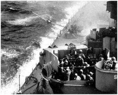 KAMIKAZE! A Japanese Zero kamikaze fighter about to crash into the battleship Missouri off Okinawa, 11 April 1945
