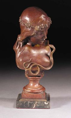 'CLÉOPÂTRE' A DARK-RED PATINATED BRONZE FIGURE cast from a model by J.DeRudder, on striated rouge socle and striated black marble and bronze base, signed in the bronze, foundry mark H.Luppens & Cie -- 31cm. high | CLASSIC ART NOUVEAU