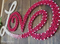 """DIY Valentine's Day String Art Kit.  On Etsy use the coupon code """"PinLove"""" and get 10% off the purchase price for any DIY Kit. Learn the art of String Art and create a Valentine's Day Crafts project with this string art kit!  The Kit comes with embroidery floss, nails, instructions, pattern, and this beautiful stained wood board.  It's a artsy, creative, fun arts and crafts DIY project! By StringoftheArt at Etsy"""