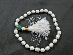 White Pearl Wrist Mala Spiritual Yoga Meditation Japamala Prayer Mala ~ 27+1 Beads - The Symbol of Feminine Wisdom Mogul Interior,http://www.amazon.com/dp/B00CE6POP4/ref=cm_sw_r_pi_dp_DIaCrbBEA5574583
