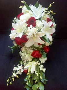 Mccary favorite Bridal Bouquets - Cascade with white lily, red roses, white dendro, and queenannes lace. Prom Flowers, Bride Flowers, Bride Bouquets, Wedding Flowers, Summer Wedding Bouquets, Lily Wedding, Wedding Flower Design, Floral Wedding, Cascade Bouquet