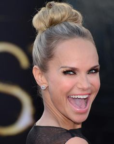 Kristen Chenoweth arrives on the red carpet for the 85th Academy Awards.