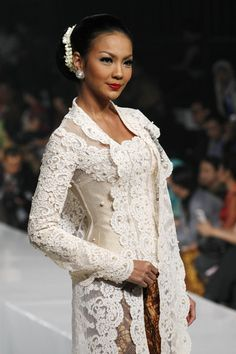 """A model showcases designs on the runway by Marga Alam as part of the Opening Night """"Styling Modernity: A Tribute To Kebaya"""" show opening Jakarta Fashion Week 2010 at the Fashion Tent, Pacific Place on November 6, 2010 in Jakarta, Indonesia."""