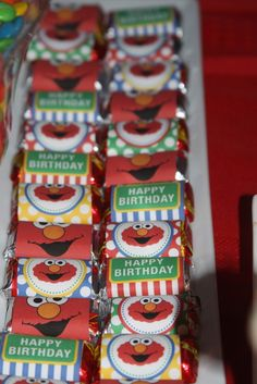 Mini Candy Bars at a Elmo Sesame Street Party #elmoparty #sesamestreet- Kelly Meadows- click on the website once you click on this pin; everything you ever wanted for a sesame street bday