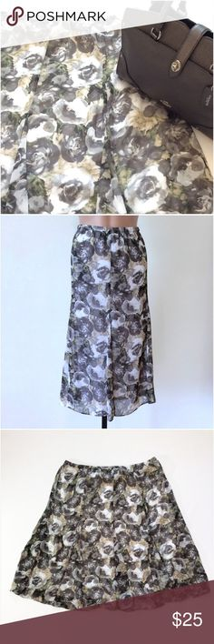 "Gray Multi Color Floral Skirt Size 1X New with tags! Colors are gray, white, beige, black and green.  Elastic waist.  White lining.  100% polyester.  Grodet style cut.   Measurements were taken with the skirt laying flat unstretched:  20 1/2"" elastic waist, 29 1/2"" length, 30"" hips, and 33"" bottom opening. Multiply measurements by 2 where appropriate to get the full circumference where needed. #pretty #trendy #romantic #whimsical #comfy #everyday #career #office #business #versatile #fun…"