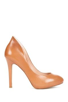 Unexpected twist on the classic camel pump.  The high heel line is to die for!