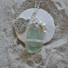 Just ordered :) Blue Seaglass Necklace with Sanddollar Charm and Pearls. Etsy.
