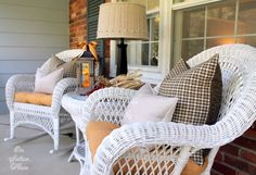beautiful fall front porch. love that they brought a lamp outside!