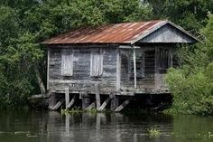 wouldn't it be nice to boat out to this house on the bayou and just knit all summer long?